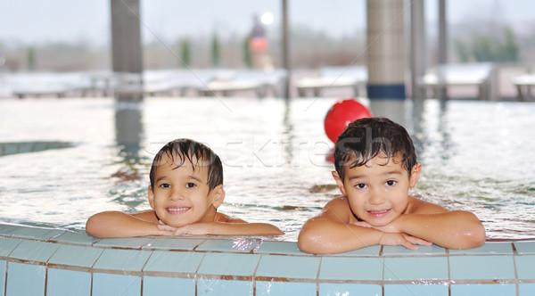 Kinderen spelen mooie zwembad water glimlach Stockfoto © zurijeta