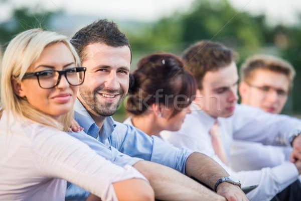 Five modern people sitting Stock photo © zurijeta