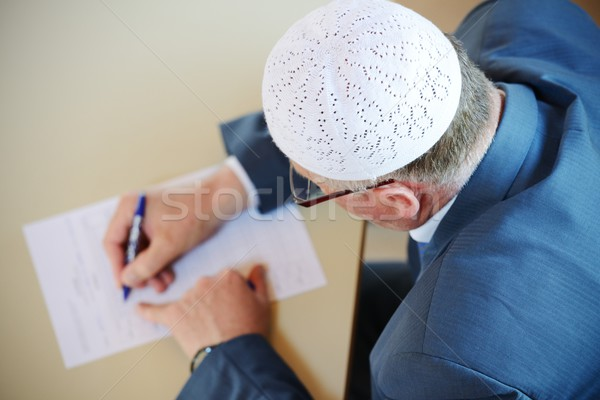 Old man writing with selective focus image Stock photo © zurijeta