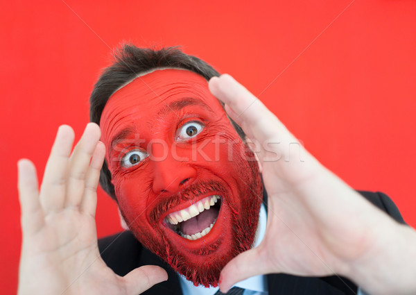 Young man portait with red painted face and copy space Stock photo © zurijeta