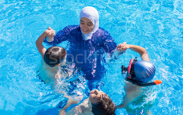 Muslim girl with special swimming suit Stock photo © zurijeta