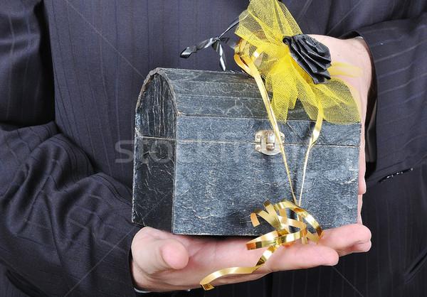 Nice gift chest in hands of businessman in suite Stock photo © zurijeta