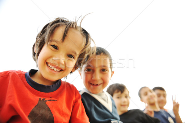 Below view of happy children embracing each other and smiling at camera Stock photo © zurijeta