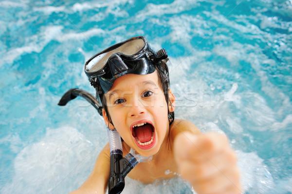 Energetic child in pool Stock photo © zurijeta