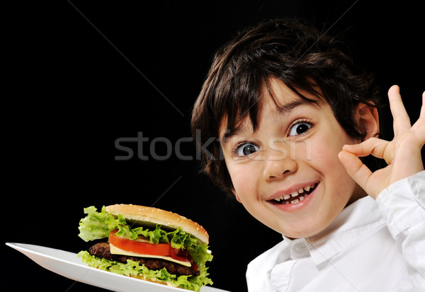 Kid serving burger Stock photo © zurijeta