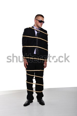 Businessman executive tied up with a rope Stock photo © zurijeta