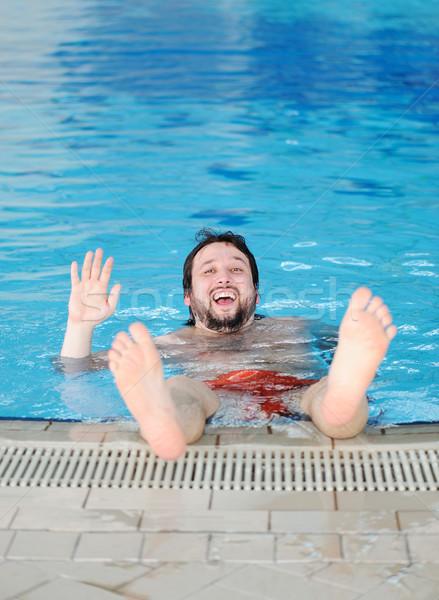 swimming man, fun in pool Stock photo © zurijeta