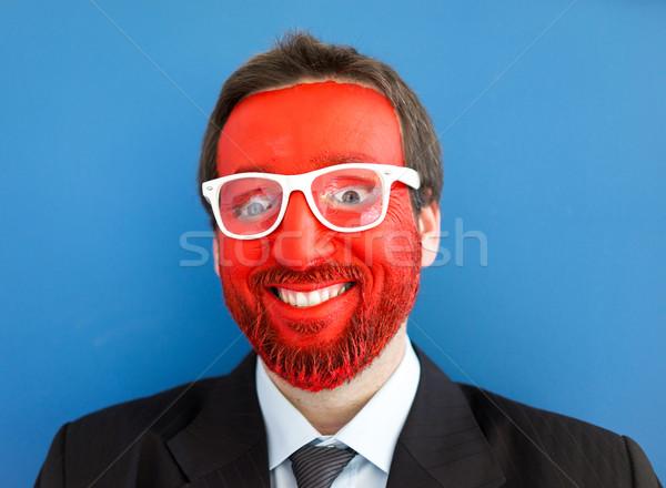 Uomo Crazy occhi sorriso faccia blu Foto d'archivio © zurijeta