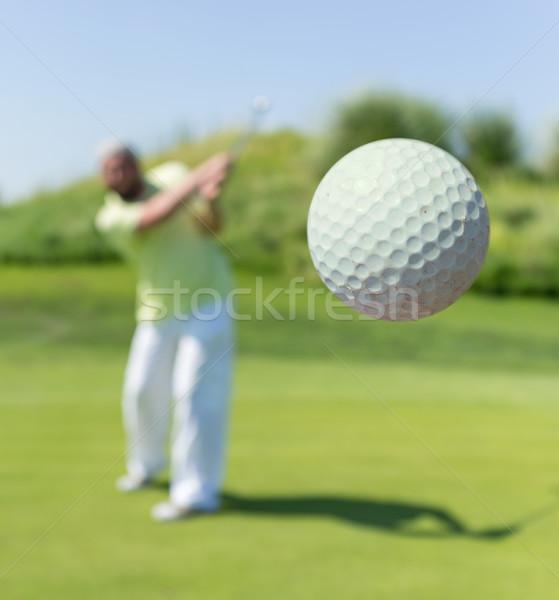 Successful man playing golf at club Stock photo © zurijeta