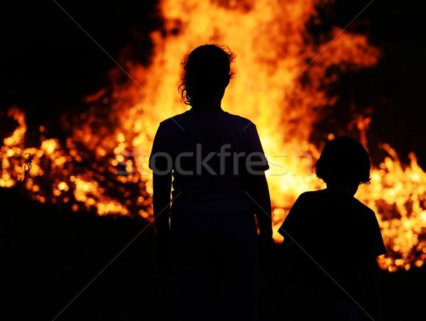 Two children looking at big fire Stock photo © zurijeta