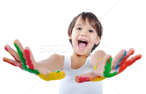 Five year old boy with hands painted in colorful paints ready for hand prints  Stock photo © zurijeta