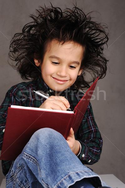 Stockfoto: Glimlachend · weinig · jongen · tekening · familie · school