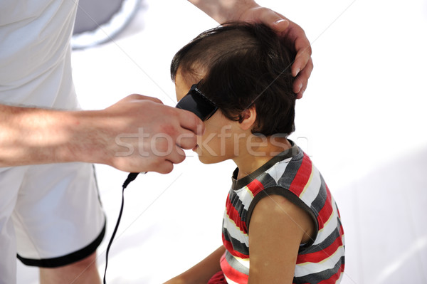 Haircut, cute kid taking off entire hair Stock photo © zurijeta