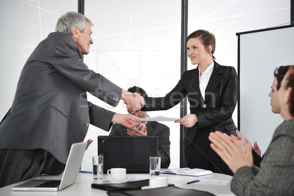 Business partners handshaking at meeting and receiving applause Stock photo © zurijeta