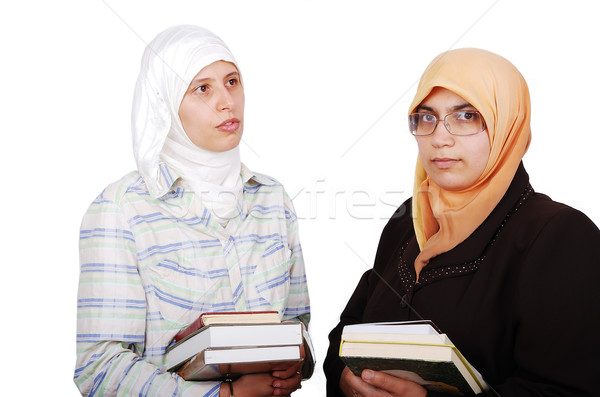 A young muslim women in traditional clothes in education process Stock photo © zurijeta