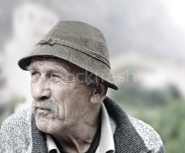 Elderly man's face over white background Stock photo © zurijeta