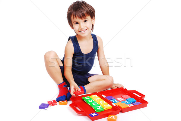 Children playing with cubes in white isolated space Stock photo © zurijeta