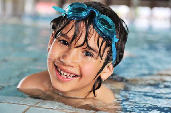 Aranyos kicsi gyerek úszómedence fiú arc Stock fotó © zurijeta