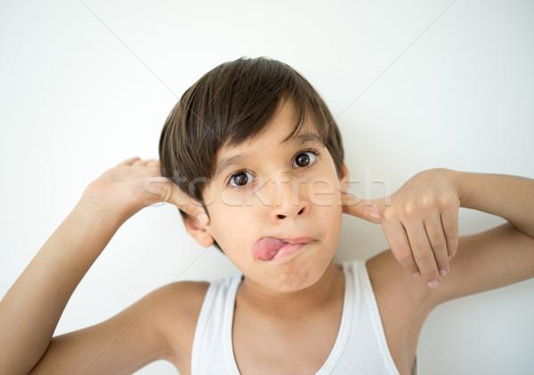 Cute kid mocking Stock photo © zurijeta