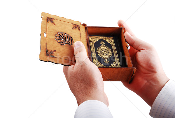 Koran, islam holy book hold by male hands Stock photo © zurijeta