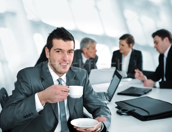 Businessman in business ambience drinking cofee Stock photo © zurijeta
