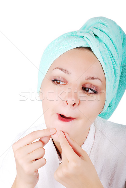 A pretty girl finding an acne on her chin Stock photo © zurijeta
