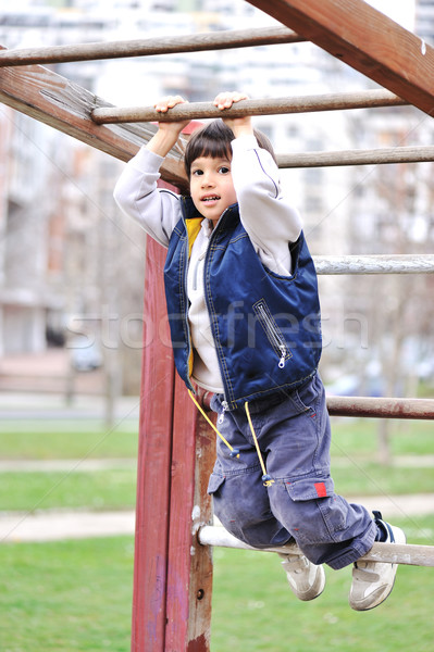 Boy climbing stairs od playground Stock photo © zurijeta