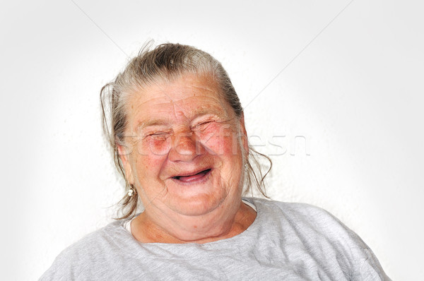 Old aged female person, very delightful and funny face Stock photo © zurijeta