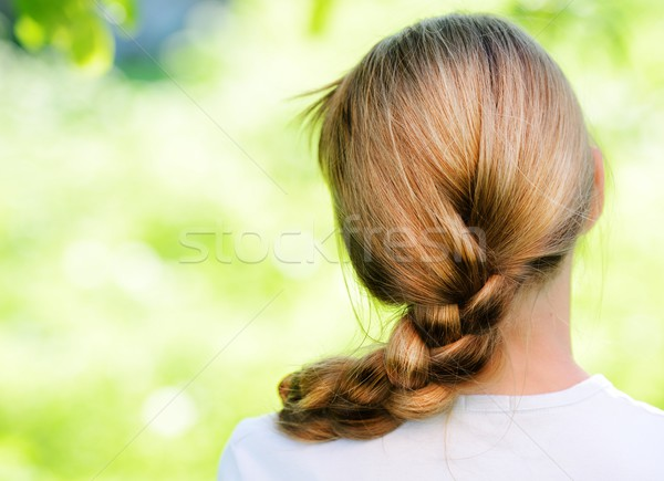 Teenager blonde girl with braid pigtails in nature Stock photo © zurijeta