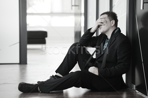Portrait of a stressed disappointed businessman sitting alone on Stock photo © zurijeta