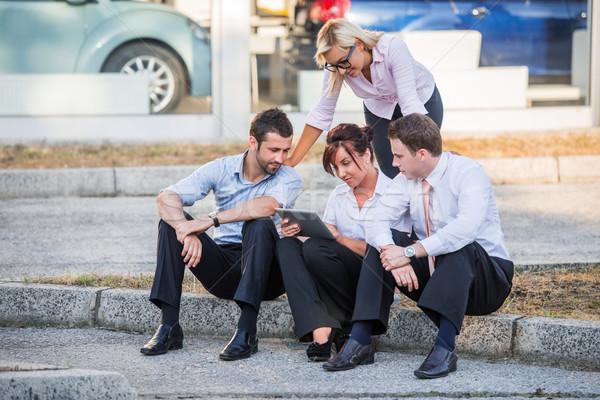 Four business people on sidewalk Stock photo © zurijeta