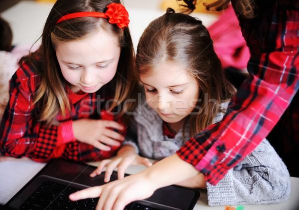 Aranyos iskolások osztályterem oktatás tevékenységek laptop Stock fotó © zurijeta