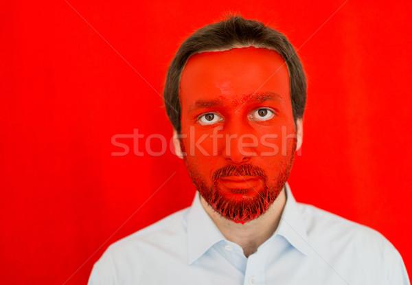 Giovane rosso verniciato faccia copia spazio sorriso Foto d'archivio © zurijeta