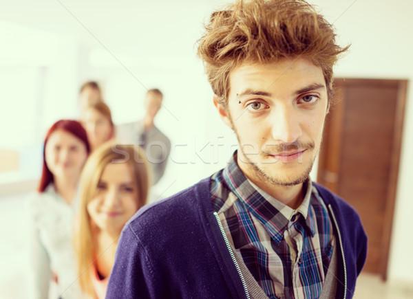 Derűs diákok áll folyosó középiskola mosoly Stock fotó © zurijeta
