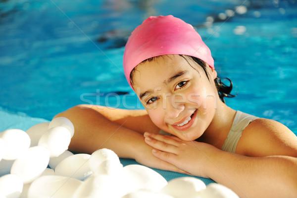 Lány medence mosoly gyerekek boldog sportok Stock fotó © zurijeta