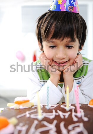 Boys with candles on cake, happy birthday party Stock photo © zurijeta