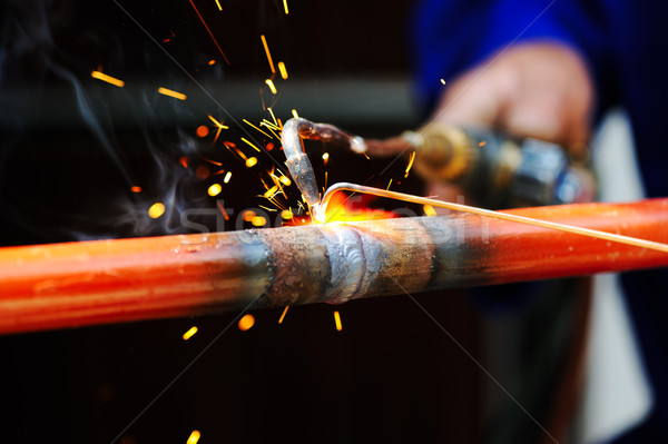 welder using torch on metal object Stock photo © zurijeta