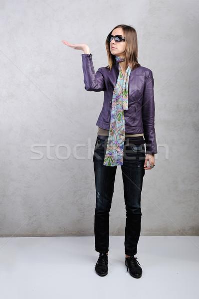 Beautiful woman with her palm up hand gesture Stock photo © zurijeta
