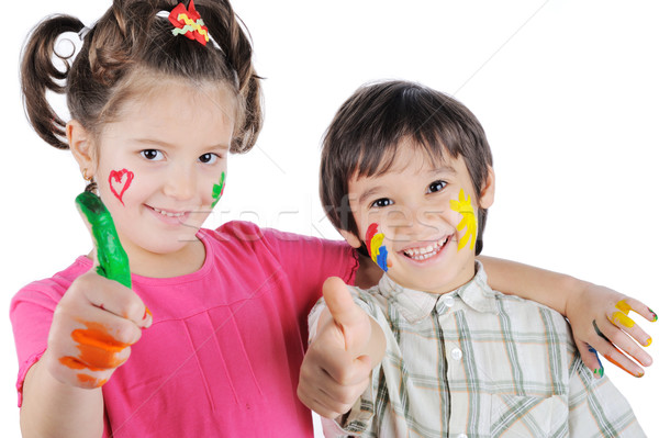 Smiling brother and sister with pant on hands and face Stock photo © zurijeta
