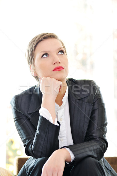 Young business woman sitting at office and thinking Stock photo © zurijeta