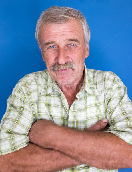 Stock photo: Smiling and confident mature man with mustache, wrinkles and gre