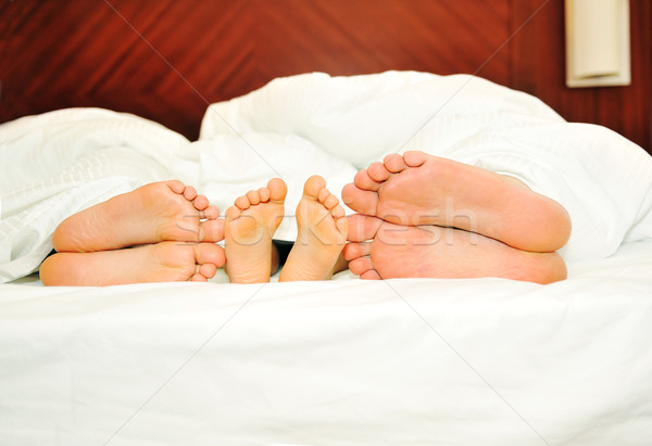 Happy family in bed, six feet Stock photo © zurijeta