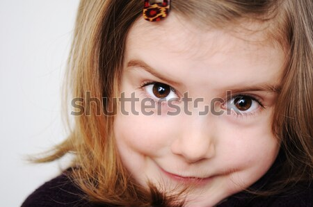 Stock photo: Adorable little girl making silly funny faces isolated on white background
