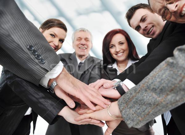 группа счастливым улыбаясь рук вместе Сток-фото © zurijeta