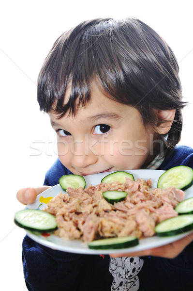 Kid with tuna on plate Stock photo © zurijeta