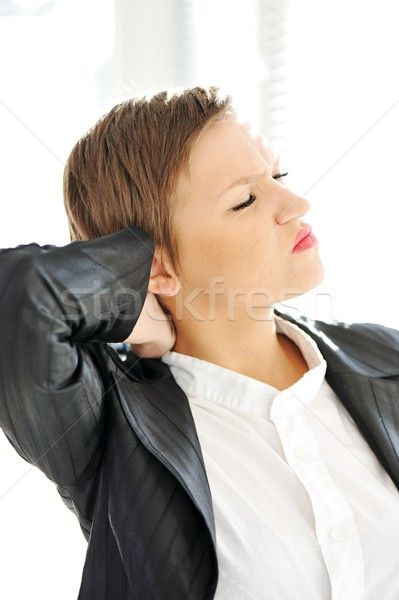 Young business woman suffering from severe neck pain Stock photo © zurijeta
