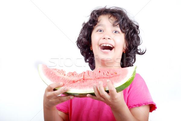 Caucasian girl offers a watermelon Stock photo © zurijeta