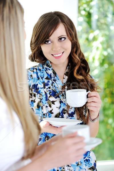 Friends enjoy a hot cup of coffee Stock photo © zurijeta