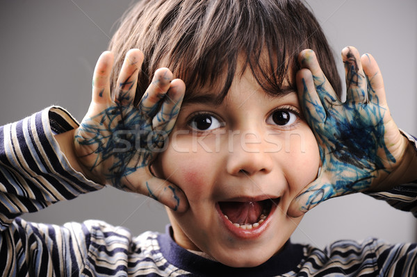 Excited little boy with messy color hands Stock photo © zurijeta