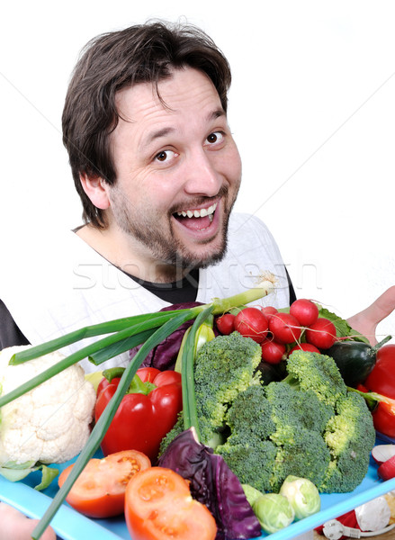 Man with many different vegetables Stock photo © zurijeta